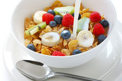 Fruits corn flakes pouring milk Royalty Free Stock Photo