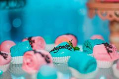 Fruits covered with pink and light blue chocolate and edible sug Royalty Free Stock Photography