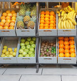 Fruits. Crates with fresh fruits in juice bar Royalty Free Stock Photos