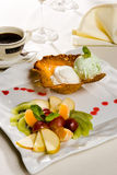 Fruits and a cup. Dessert with fruits and a cup of coffee Stock Images