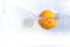 Fruits dans l'eau Photos libres de droits