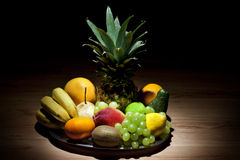 Fruits in the dark Stock Images