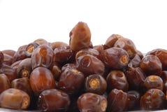 Fruits de datte dans une plaque Photographie stock libre de droits
