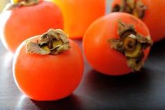 Fruits de kakis Photos libres de droits