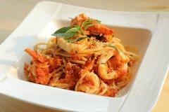 Fruits de mer de spaghetti avec le concasse de tomate Photos libres de droits