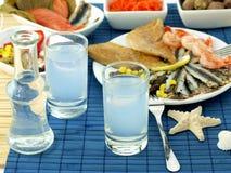 Fruits de mer et ouzo Image stock