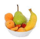 Fruits in deep plate Stock Photography