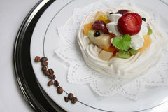 Fruits in delicious dessert. On the plate Stock Photography
