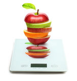 Fruits on digital weight scale Royalty Free Stock Images