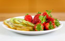 Fruits on dish Stock Images