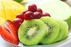 Fruits on the dish. Dish of fresh and colorful of strawberry, grape, kiwi, mango, apple Stock Images