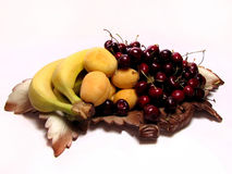Fruits on a dish in the form of grape leaves Stock Images