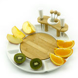 Fruits on plate. Oranges, apples and kiwies on a white china fruit dish Stock Photo