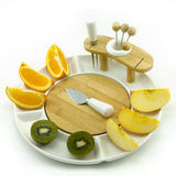 Fruits on plate. Oranges, apples and kiwies on a white china fruit dish Royalty Free Stock Photography