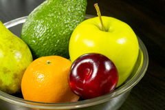 Fruits in dish on table. Diet, vegetable food, healthy eating and objects concept - close up of ripe fruits and vegetables in dish on table Stock Photos