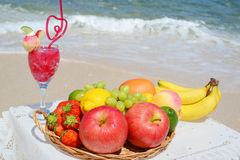 Fruits and drink on the Beautiful beach Stock Photo