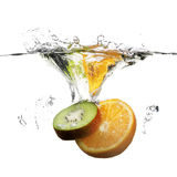 Fruits Dropped In Water With Splash Stock Photo