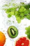 Fruits dropped into water Royalty Free Stock Photography