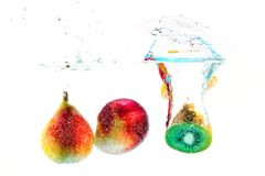 Fruits falling in the water Stock Image