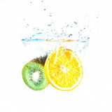Fruits falling into water Stock Images