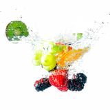 Fruits falling into water. And splash Royalty Free Stock Photography