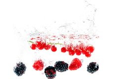 Fruits falling in the water Royalty Free Stock Image