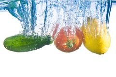 Fruits fell into the water. Close-up Stock Images