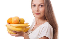Fruits in female hands Stock Image