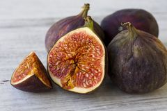 Fruits figs on white background. Slices of ripe figs on a white background Royalty Free Stock Image