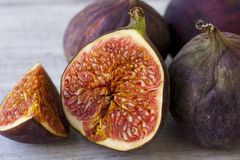 Fruits figs on white background. Slices of ripe figs on a white background Royalty Free Stock Photos