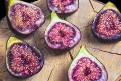 Fruits figs on wooden stump Stock Images