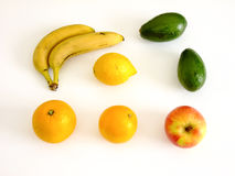 Fruits Flat Lay. Flat Lay Composition of Bananas, Oranges, Apples, Lemon and Avocado in white Background Royalty Free Stock Images