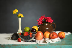 Table with Fruits and Flowers. Fruits and flowers over vintage table royalty free stock photography