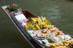 Fruits and food on boat Stock Photos