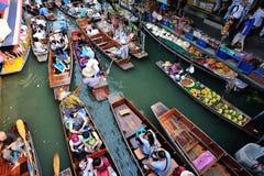 Fruits and food with boats at Damonen Saduak floating market Royalty Free Stock Photo