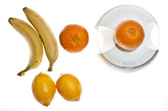 Fruits on food scale Stock Images