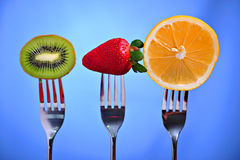 Fruits in fork royalty free stock photos