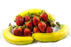 Banana`s and straberry`s. Fruits of four different banana cultivars A banana is an edible fruit – botanically a berry[1][2] – produced by several kinds of Royalty Free Stock Photography