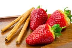 Fruits frais et cannelle Photographie stock