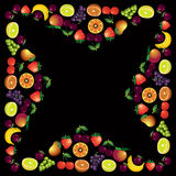 Fruits frame made with different fruits over dark background, he Stock Photography