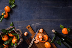 Fruits, fresh oranges with leaves. Healthy food background. Top view, copy space. Stock Images