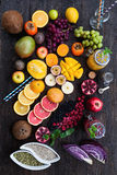 Fruits and frozen berries. On dark rustic wooden table. Purple and yellow smoothie bowl formula. Clean eating concept. Various green and red veggies, fruit and Royalty Free Stock Images