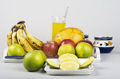 Fruits and Fruit Juice. Mixed Fruits and Orange Juice Glass with spoon Stock Photos