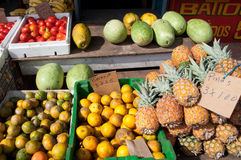 Fruits at Fruit Stand, Panama, Central America. Pineapples, oranges. limes and tomatoes are on display for sale at fruit stand in Panama, Central America Stock Photos