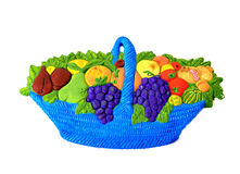 Fruits full coloured basket. Full coloured basket with fruits and vegetables, made in pottery Stock Image