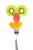 Fruits funny face on a fork Stock Photography