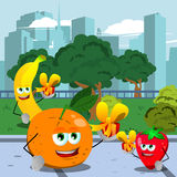 Fruits giving you a gift box in the city park Stock Images