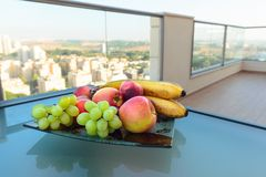 Fruits on a glass table royalty free stock photography