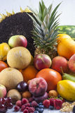 Fruits. Group shoot of colorful fresh edible fruits on a solid  bright blue wooden table Royalty Free Stock Photo