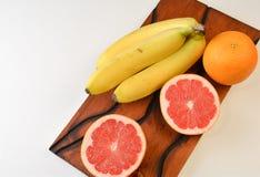 Fruits on a handmade pinewood tray Royalty Free Stock Photos